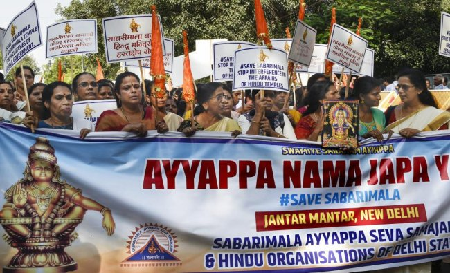 Lord Ayyappa devotees take part in the \'Ayyappa Namajapa Yatra\' (chanting the name of Lord Ayyappa) in New Delhi on Sunday. (PTI Photo)