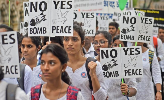 Students hold placards as they participate in a rally to commemorate Hiroshima Day, in Mumbai on Monday. PTI Photo
