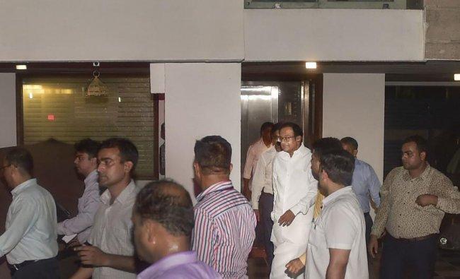 Central Bureau of Investigation (CBI) officials escort Congress leader P Chidambaram from his Jor Bagh residence in New Delhi, Wednesday, Aug 21, 2019.