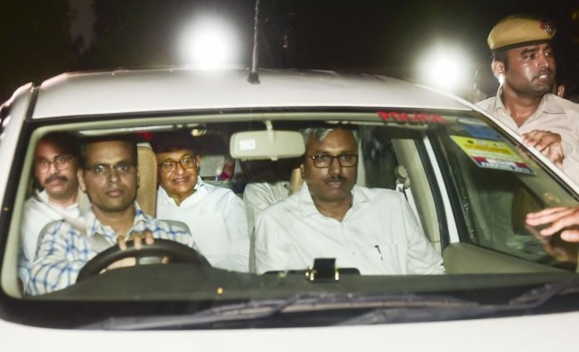Central Bureau of Investigation (CBI) officials arrest Congress leader P Chidambaram from his Jor Bagh residence in New Delhi, Wednesday, Aug 21, 2019. (PTI Photo)