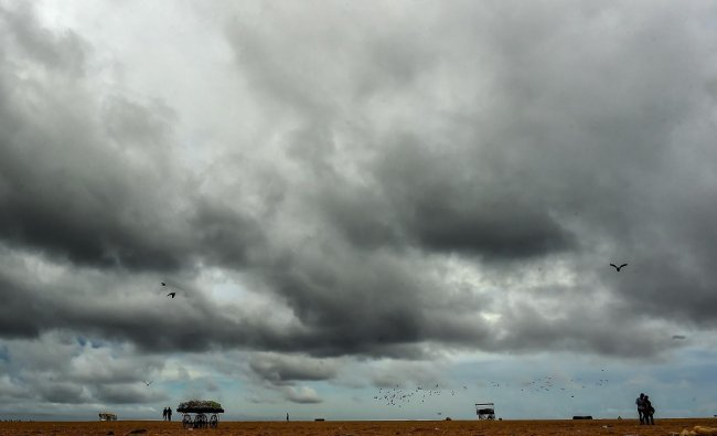 Clouds hover in the sky over Marina beach in Chennai. PTI photo