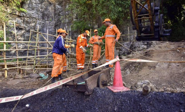 NDRF personnel conduct a rescue task at the site of a coal mine collapse at Ksan, in Jaintia Hills district of Meghalaya. PTI