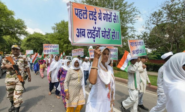 Congress Sewa Dal workers participate in a \'Tiranga March\' to commemorate the 76th anniversary of Quit India Movement, in New Delhi on Thursday. PTI photo