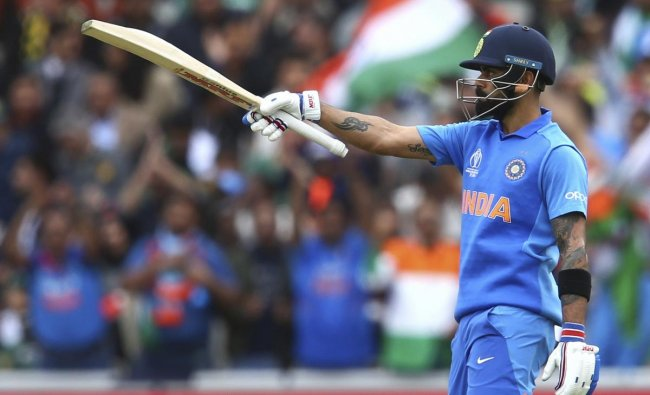 India\'s captain Virat Kohli raises his bat to celebrates reaching a half century during the Cricket World Cup match between India and Pakistan at Old Trafford in Manchester, England, Sunday, June 16, 2019. AP/PTI