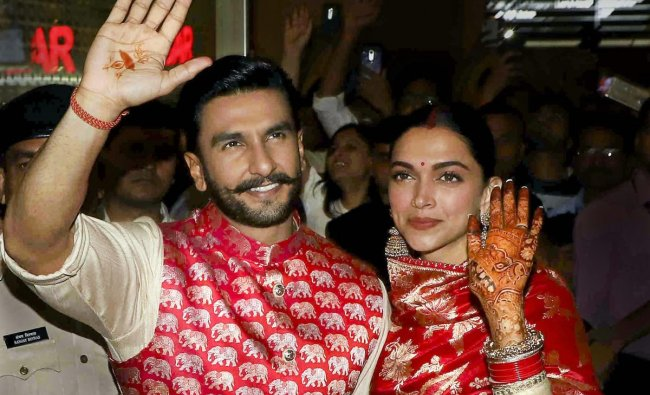 Newly-wed Bollywood stars Deepika Padukone and Ranveer Singh, who recently tied knot in a private ceremony at Lake Como in Italy, on their arrival in Mumbai. PTI photo