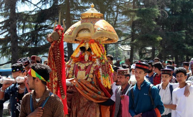 Devotees carry palanquin of a deity during a procession on the first day of a week-long Dussehra celebrations, in Kullu, Tuesday, Oct. 8, 2019. (PTI Photo)