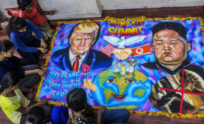 Student make a painting of the US President Donald Trump and North Korean leader Kim Jong-Un ahead of their meet at Singapore Summit, in Mumbai on Monday. PTI Photo