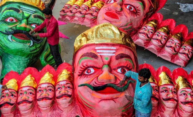 A man works on effigies of the demon-king Ravana at a workshop, ahead of Dussehra festival in Nagpur. (PTI photo)