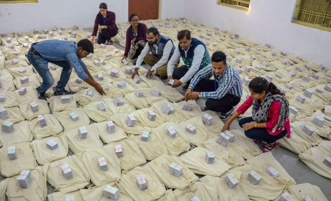 Jabalpur: Election officials check Electronic Voting Machines (EVM) ahead of Madhya Pradesh Assembly elections, in Jabalpur, Saturday, Nov. 24, 2018. (PTI Photo)