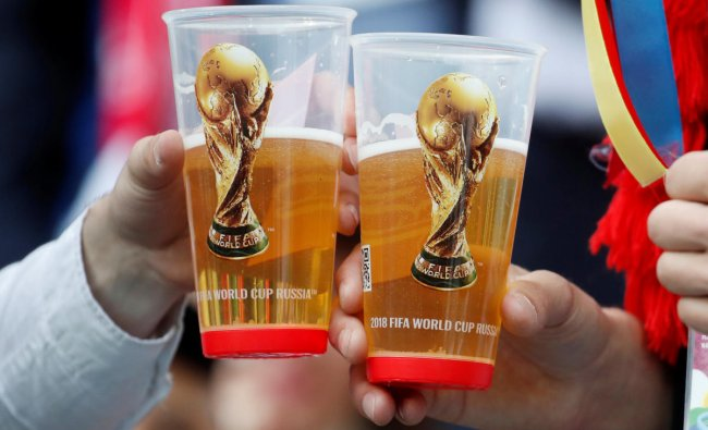 World Cup - Group A - Russia vs Saudi Arabia : Fans holding their drinks before the match in Luzhniki Stadium, Moscow, Russia.REUTERS