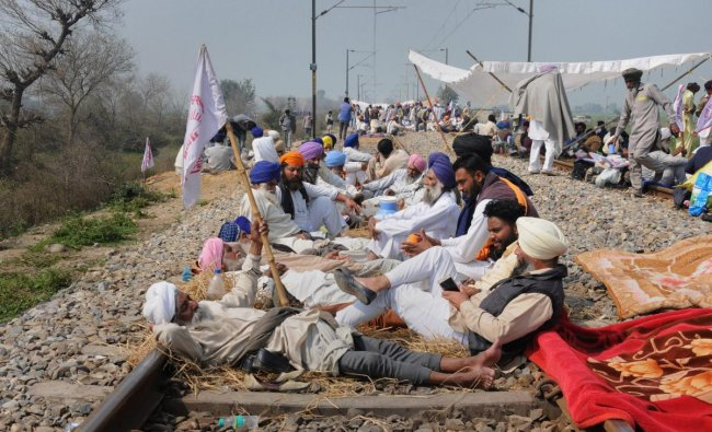 Farmers block a railway tracks during a protest organized under the banner of Kisan Mazdoor Sangharsh Committee (KMSC) against the alleged anti-farmer policies of the state government, at village Devi Dass Pura, 20 km from Amritsar. PTI