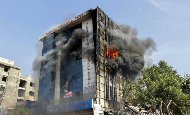 Smoke billows out after a fire broke out in a multi-storey building in Jodhpur. (PTI photo)