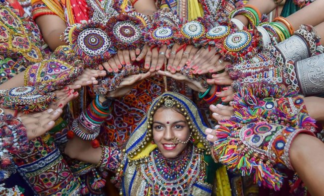 Dancers dressed in traditional attire during the rehearsals for the \'Garba\' dance ahead of nine-day Navratri festival in Ahmedabad. PTI Photo