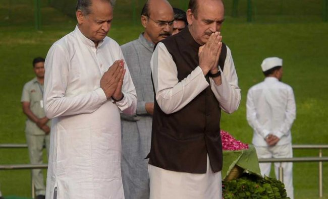 Senior Congress leaders Ghulam Nabi Azad and Ashok Gehlot pay tribute to India\'s first prime minister Pandit Jawaharlal Nehru on his 54th death anniversary, at Shanti Van, in New Delhi on Sunday. PTI Photo