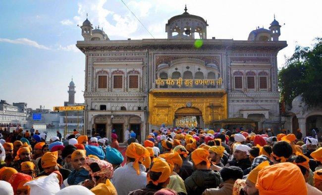 Devotees offer prayers at Sri Harmandir Sahib (Golden Temple) on the birth anniversary of tenth Sikh guru, Guru Gobind Singh Ji, in Amritsar. PTI photo