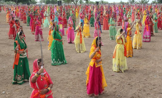 This handout photo taken on August 23, 2019 and released by the Gujarat Information Department, Jamnagar on August 24, 2019, shows Indian women of the Rajput community performing \