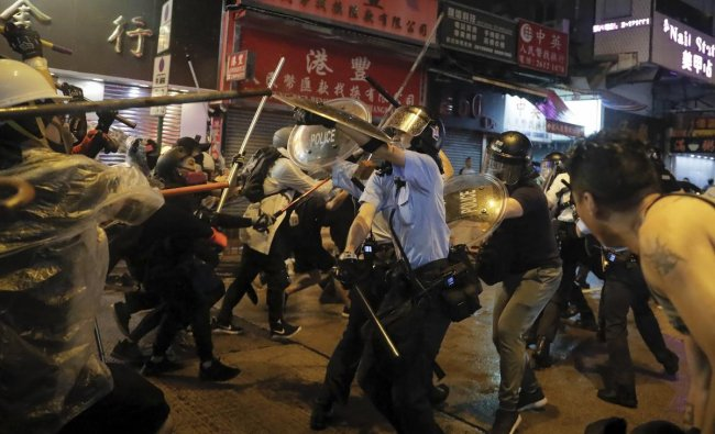 Policemen clash with demonstrators on a street during a protest in Hong Kong, Sunday, Aug. 25, 2019. (AP/PTI)