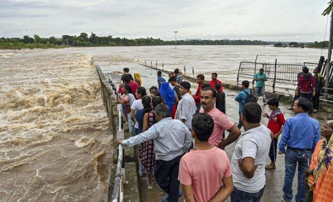 A view of a flooded bridge following heavy monsoon rainfall, in Jabalpur. PTI