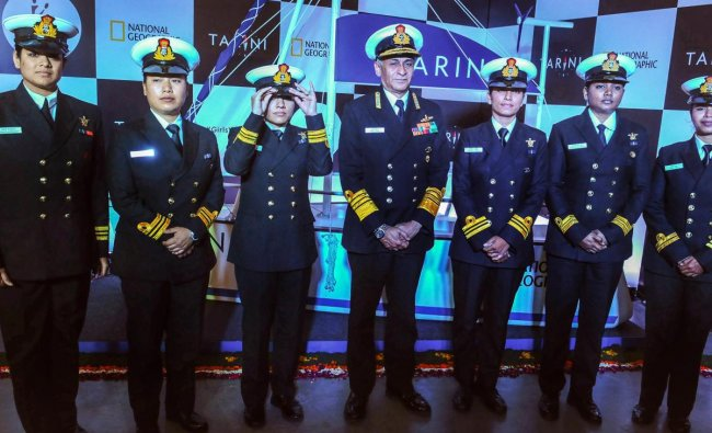 Chief of Naval Staff Admiral Sunil Lanba with the members of the all-women crew, who circumnavigated the globe onboard INS Tarini, during International Women\'s Day celebrations at a college in New Delhi. PTI