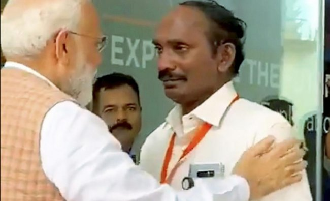 Prime Minister Narendra Modi consoles ISRO Chairman Kailasavadivoo Sivan as he got emotional after the Vikram lander connection was lost during soft landing of Chandrayaan 2 on lunar surface, in Bengaluru, Saturday, Sept. 7, 2019. (PTI Photo)