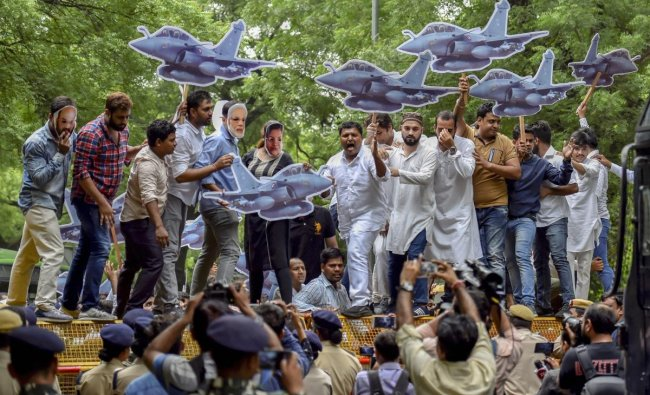 Indian Youth Congress (IYC) members stage a protest against Union Defence Minister Nirmala Sitharaman outside her residence, in New Delhi on Monday. PTI Photo