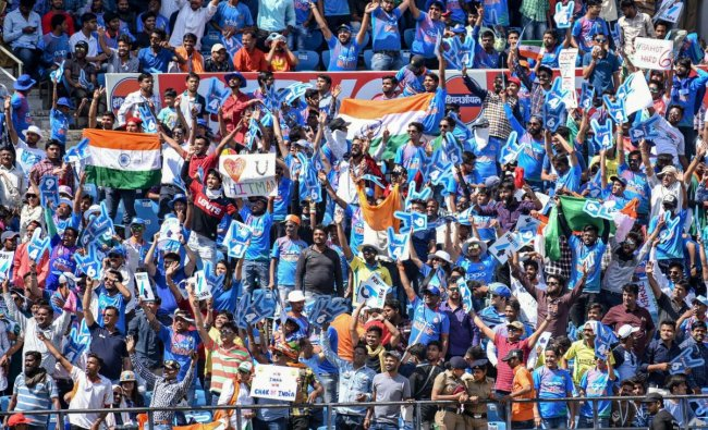 Fans cheer the Indian team during the 2nd ODI cricket match against Australia at Vidarbha Cricket Association Stadium in Nagpur. PTI