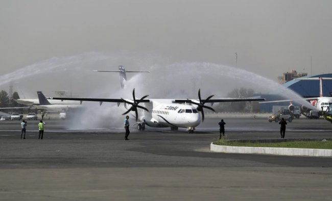In this photo provided by Tasnim News Agency, a traditional water cannon salute welcomes an Iran Air\'s new commercial aircraft at Mehrabad airport in Tehran, Iran. AP/PTI photo