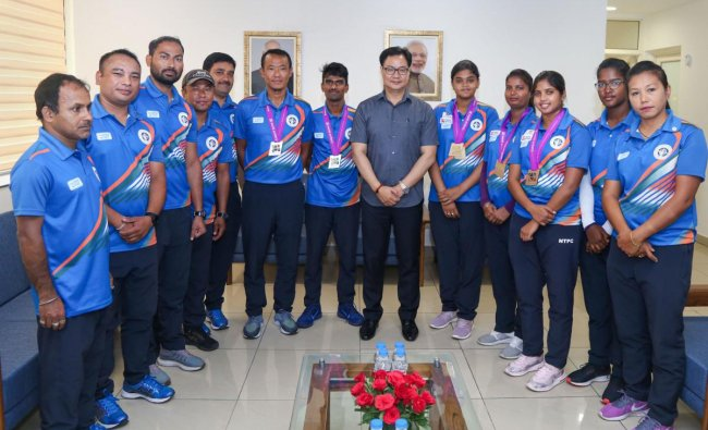 Union Minister of State (Independent) for Youth Affairs & Sports, Kiren Rijiju, pose for a photograph with the Indian archery team at Sports Authority of India, in New Delhi, Wednesday, June 19, 2019. PTI