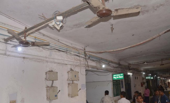 Non-working fans in a corridor at SKM College and Hospital in Muzaffarpur, Wednesday, June 19, 2019. The state-run Sri Krishna Medical College and Hospital, which is in the news these days because of the deaths of several children due to Acute Encephalitis Syndrome, is reportedly lacking facilities with many of the fans are not working properly. PTI