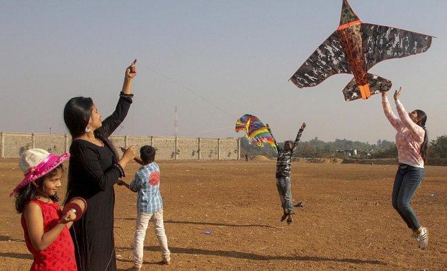 People fly kites on the eve of Makar Sakranti festival in Mumbai on Sunday. PTI photo