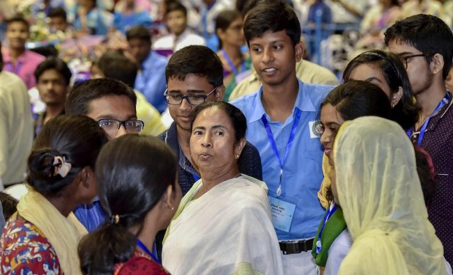 West Bengal Chief Minister Mamata Banerjee interacts with students who topped in Madhyamik Pariksha and Higher Secondary examination during their felicitation program, in Kolkata. PTI Photo