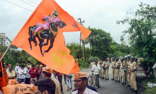 Police personnel keep a watch during a protest by Maratha Kranti Morcha, outside Panvel Tehisdar Office in Navi Mumbai. PTI photo