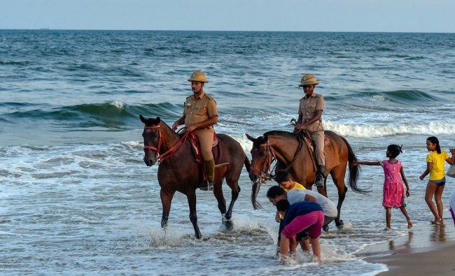Mounted police patrol the Marina Beach in Chennai. (PTI photo)