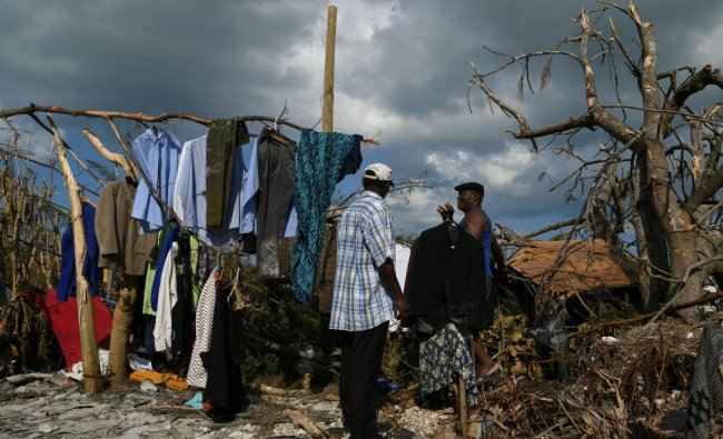Men work to salvage some of their damaged clothes in a destroyed neighborhood in the wake of Hurricane Dorian in Marsh Harbour. (Photo by Reuters)
