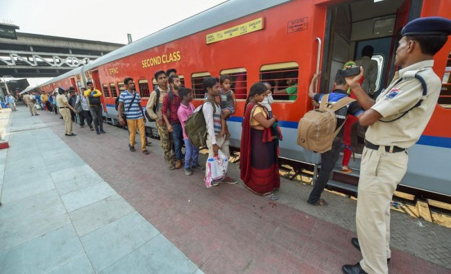 Migrant workers wait to board a train out of Gujarat in view of protests and violence breaking out over the alleged rape of a 14-month-old girl, in Ahmedabad. (PTI photo)