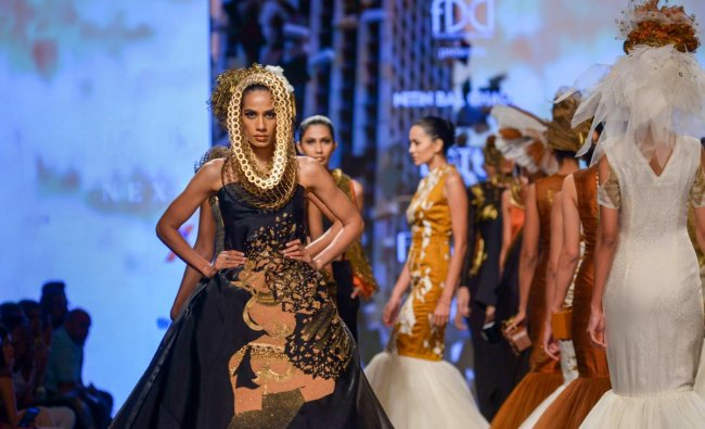 A model presents a creation by designer Nitin Bal Chauhan at India Fashion Week, in New Delhi on Thursday. (PTI photo)