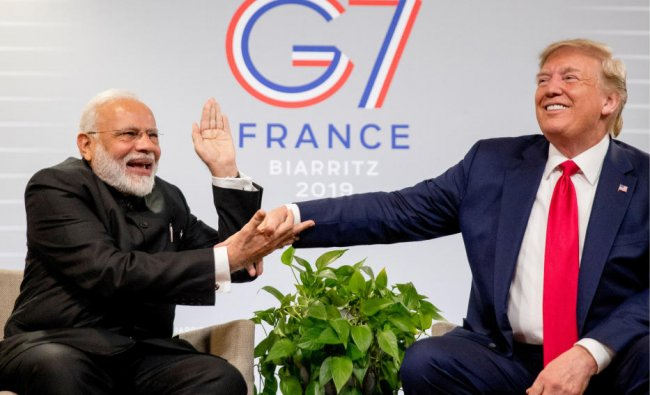 Indian Prime Minister Narendra Modi, left, slaps the hand of President Donald Trump as they share a laugh during a bilateral meeting at the G-7 summit in Biarritz, France, Monday, Aug. 26, 2019. (AP/PTI)