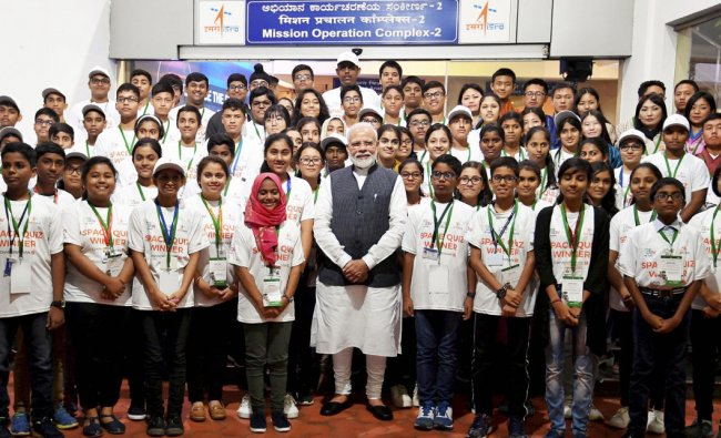 Prime Minister Narendra Modi interacts with the winners of the Space Quiz, at ISRO, in Bengaluru, Saturday, Sept. 7, 2019. (PIB/PTI Photo)