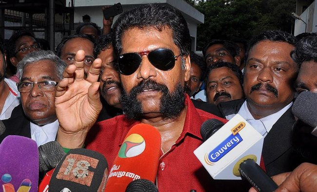 Senior journalist R Gopal, who heads the Tamil weekly magazine \'Nakkheeran\', addresses the media as he is being taken to court, in Chennai. (PTI photo)