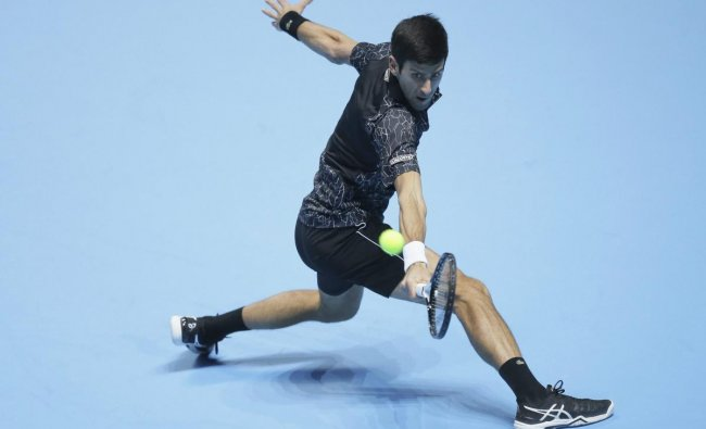 Novak Djokovic of Serbia plays a return to Kevin Anderson of South Africa in their ATP World Tour Finals singles tennis match at the O2 Arena in London. AP/PTI photo
