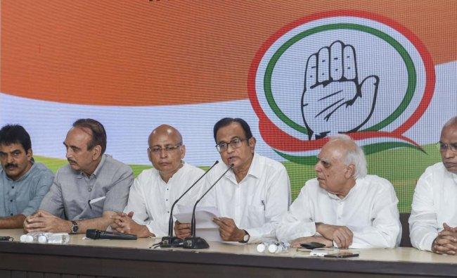 Congress leader P Chidambaram addressing a press conference with party leaders Kapil Sibal, Abhishek Singhvi, Mallikarjun Kharge, Ghulam Nabi Azad, Ahmed Patel and KC Venugopal at AICC HQ, in New Delhi, Wednesday, Aug 21, 2019. (PTI)