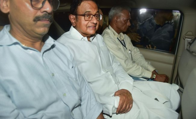 Central Bureau of Investigation (CBI) officials arrest Congress leader P Chidambaram from his Jor Bagh residence in New Delhi, Wednesday, Aug 21, 2019. (PTI)