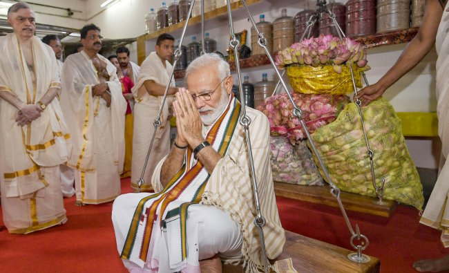 Prime Minister Narendra Modi weighed against lotus flowers as he offers his prayers at Lord Krishna temple in Guruvayur of Thrissur district, Saturday, June 8, 2019. (PIB/PTI Photo)