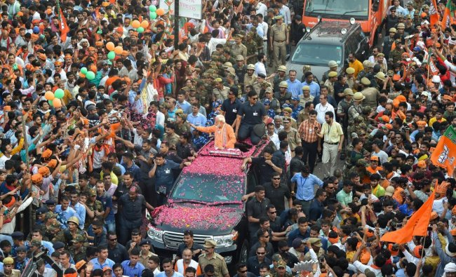 Prime Minister Narendra Modi waves at supporters during his roadshow, a day ahead of filing his nomination papers for the Lok Sabha polls, in Varanasi, Thursday, April 25, 2019. (PTI Photo/Manvender Vashist)
