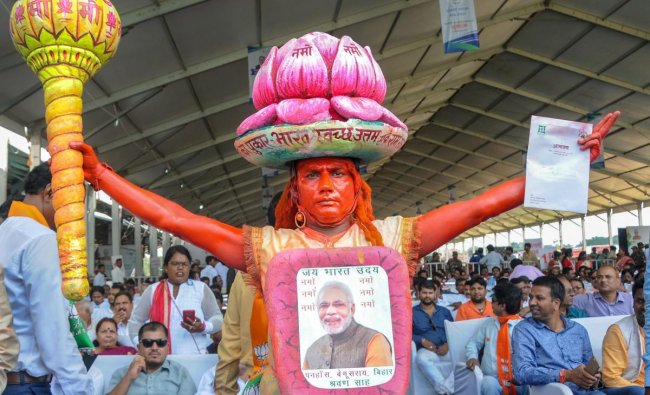 Ranchi: A BJP supporter dressed like Lord Hanuman poses for photos during the launch of Ayushman Bharat-National Health Protection Mission (AB-NHPM) by Prime Minister Narendra Modi, in Ranchi, Sunday, Sept 23, 2018. (PTI Photo)