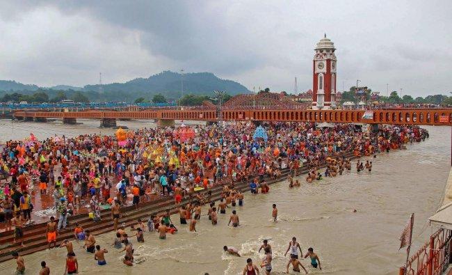Haridwar: Shiva devotees \'kanwariyas\' collect Ganga water during the holy month of Shravan, in Haridwar on Thursday, Aug 2, 2018. (PTI Photo)