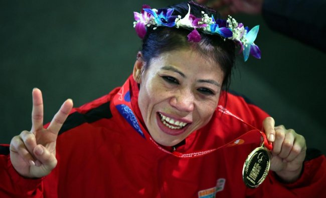 New Delhi: Indian boxer Mary Kom celebrates gold medal after winning the final match of women\'s light flyweight 45-48 kg against Hanna Okhota of Ukraine at AIBA Women\'s World Boxing Championships, in New Delhi, Saturday, Nov. 24, 2018.(PTI Photo/Manvender Vashist)