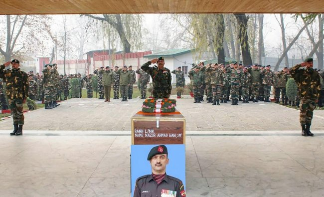 Kulgam: Army personnel pay tribute to L/NK Nazir Ahmad of 34 RR, who lost his life while fighting terrorists in Shopian, at his native village, in Chak Ashmuji in Kulgam district of South Kashmir, Monday, Nov. 26, 2018. (PTI Photo)