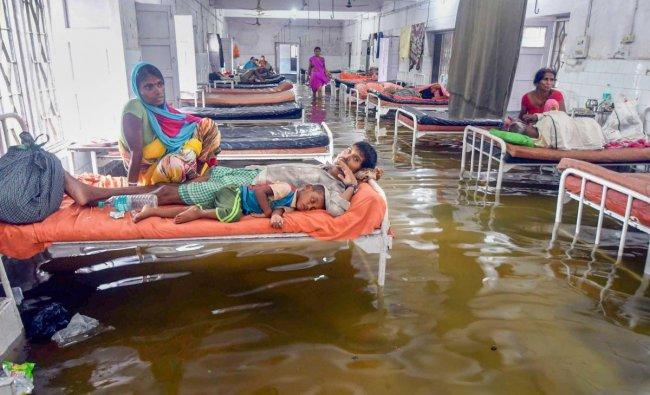 Patna: Waterlogging at Nalanda Medical College and Hospital (NMCH), after heavy monsoon rains in Patna on Saturday, July 28, 2018. (PTI Photo)