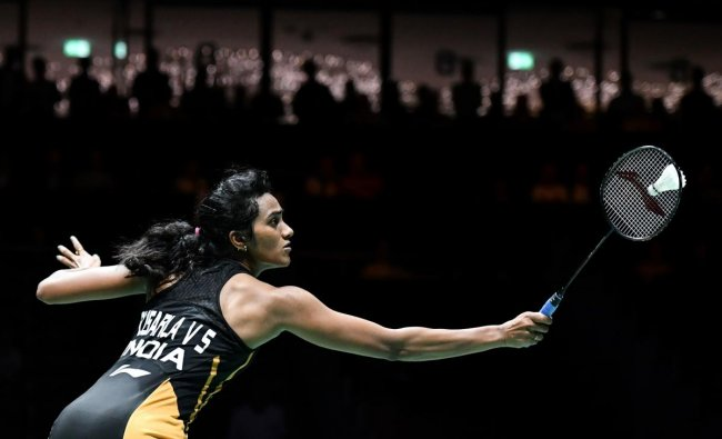 India\'s PV Sindhu returns the shuttlecock to Taiwan\'s Tai Tzu-ying during theirr women\'s single quarter-final match at the BWF Badminton World Championships at the St. Jakobshalle in Basel on August 23, 2019. (FABRICE COFFRINI / AFP)